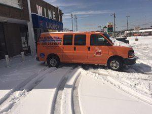 Water-Damage-Restoration-Van-In-Snow-At-Commerical-Job-Site